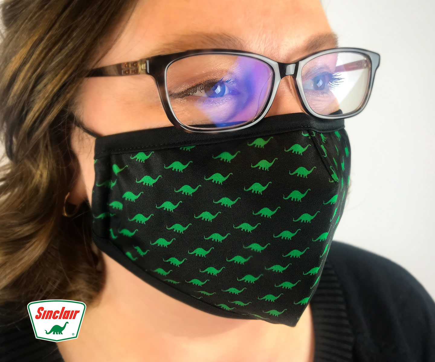 Photo of woman wearing Sinclair DINO facemask