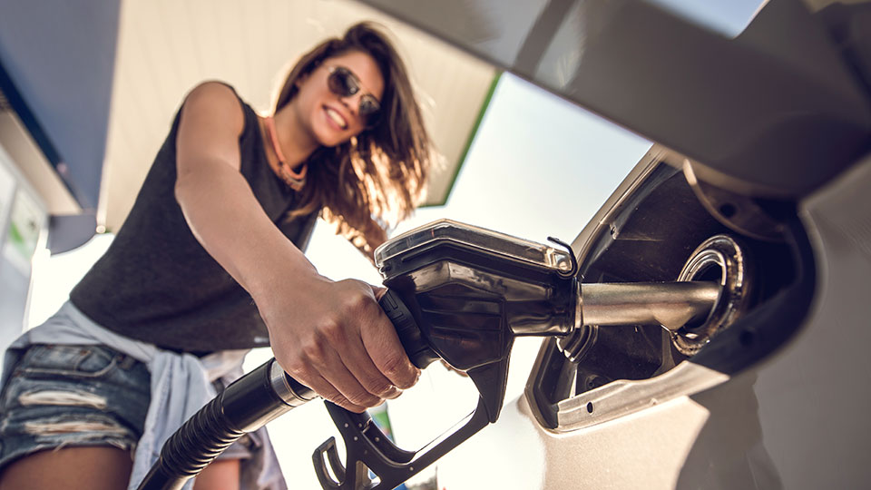 woman filling car with gas